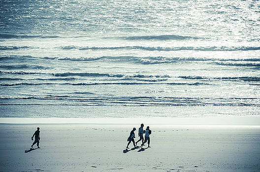 Walking along the beach by Amyn Nasser