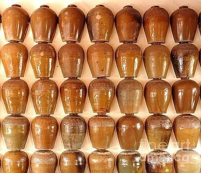 Wall of Ceramic Jugs by Yali Shi