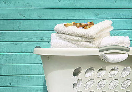 Sandra Cunningham - White laundry basket with towels and pins