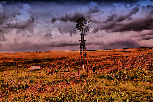 Windmill and clouds by Jeff Swan
