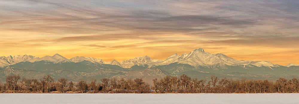 Wispy clouds over Longs Peak by Lois Lake