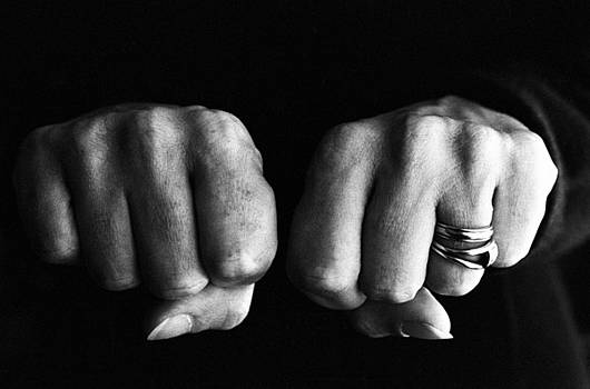 Sami Sarkis - Woman clenching two hands into fists in a fit of aggression