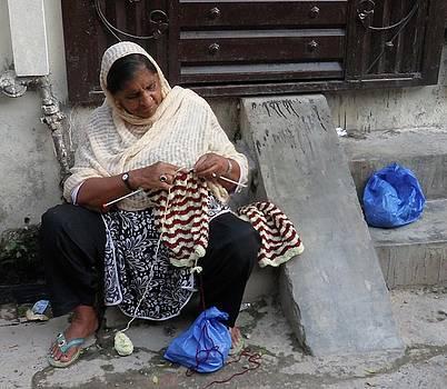 Woman Knitting Sweater by Bobby Dar