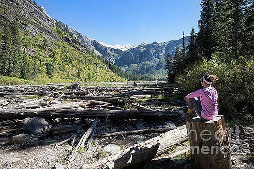 Woman Relaxing at Avalanche Lake in Glacier National Park by Brandon Alms
