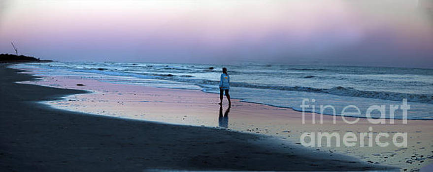 Woman Walking On Beach at Sunset by Thomas Marchessault