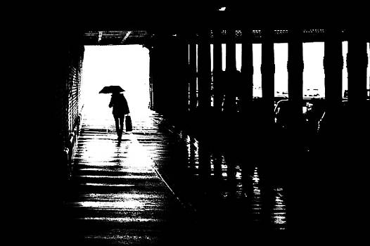 Woman with umbrella in the tunnel by Frank Andree