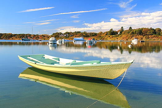 Yellow wooden rowboat on Chatham Harbor by Roupen  Baker
