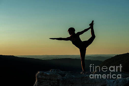 Yoga at sunset by Dan Friend