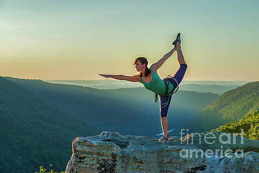Yoga on the mountain tops by Dan Friend