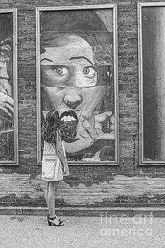 Young Girl and Wall Art Black and White by Randy Steele
