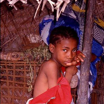Young Girl In Red - Zanzibar. oh Those by Steve Outram