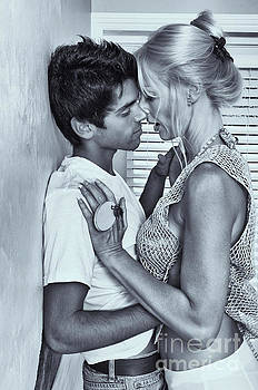 Younger man making out with older woman by Amyn Nasser