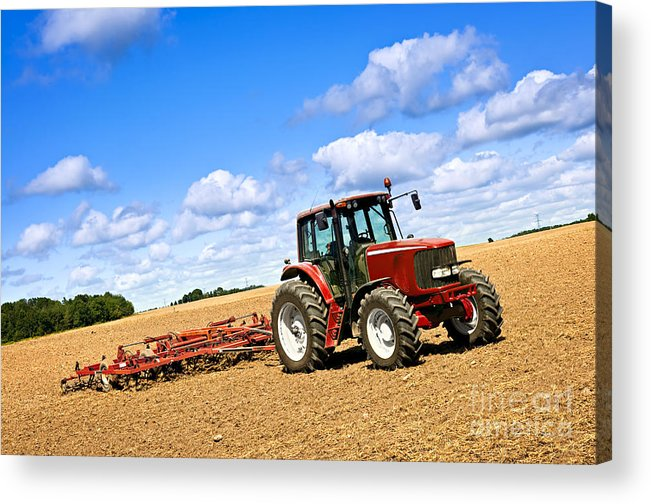 Tractor Acrylic Print featuring the photograph Tractor In Plowed Farm Field by Elena Elisseeva