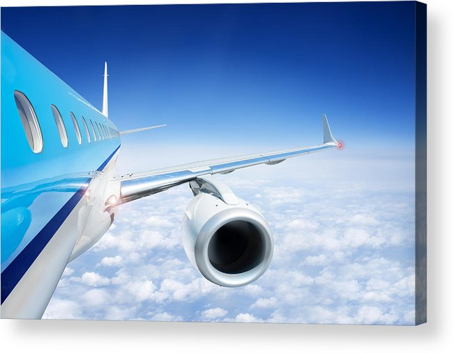 Airliner In Flight Above The Clouds Acrylic Print by Corepics