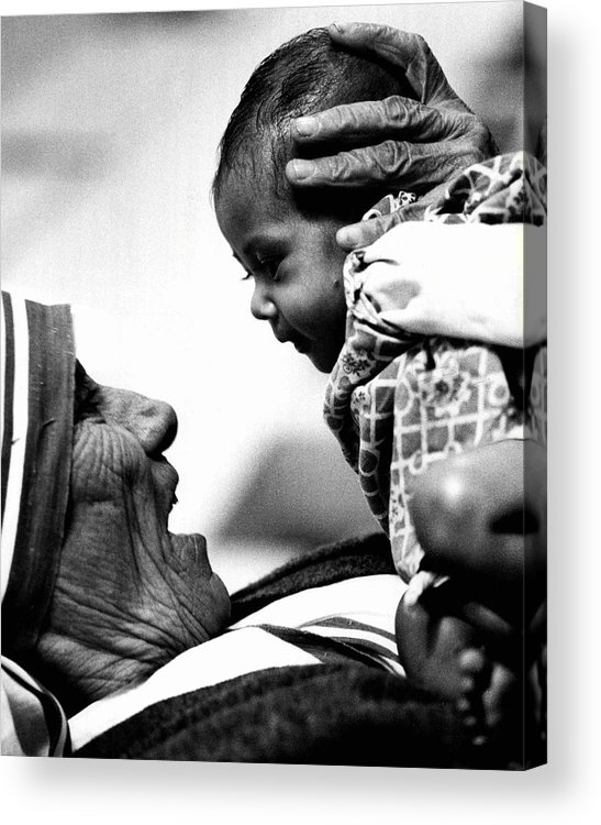 Classic Acrylic Print featuring the photograph Mother Teresa Holds Baby by Retro Images Archive