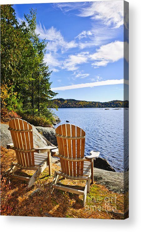 Chairs Acrylic Print featuring the photograph Adirondack Chairs At Lake Shore by Elena Elisseeva