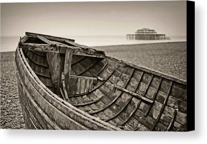 Britain Canvas Print featuring the photograph Beached At Brighton In Sepia by Tony Grider