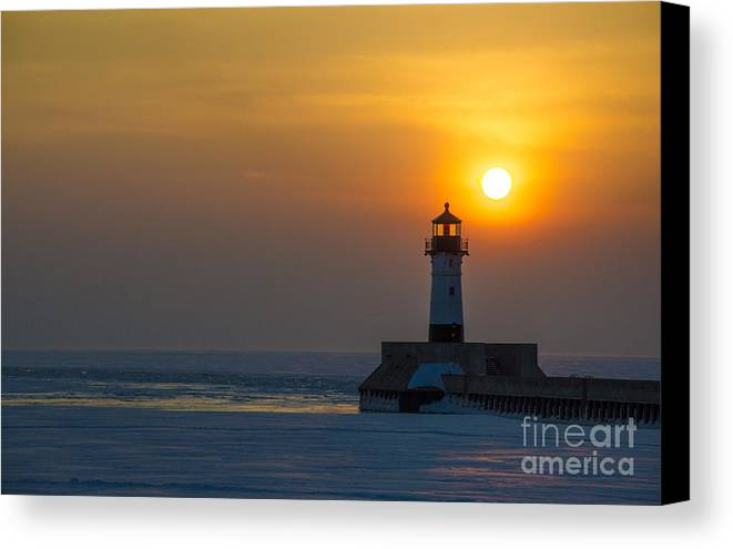 Sunrise Canvas Print featuring the photograph First Sunrise by Ronny Purba