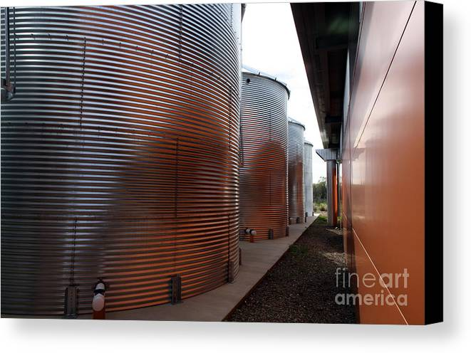 Warm Canvas Print featuring the photograph Glowing Silos by Juan Romagosa