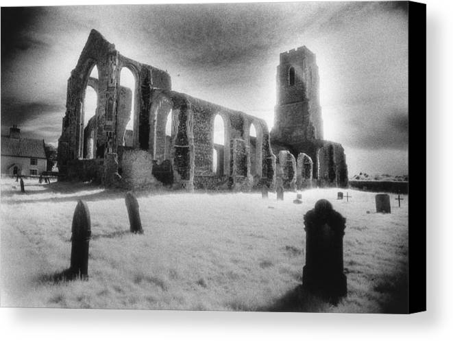 Bell Tower; Ruined; Ruin; Remains; Churchyard; Cemetery; Graveyard; Tombstones; Gravestones; Eerie; Atmospheric; Sinister; Ghostly; Dramatic; Striking; Mysterious; Gothic; Medieval; Architecture; English; Exterior; Landscape Canvas Print featuring the photograph Church Of St Andrew by Simon Marsden