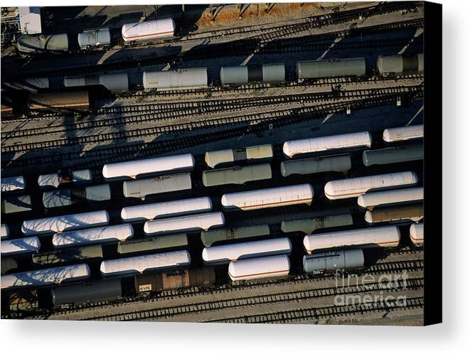 Cargo Canvas Print featuring the photograph Carriages Of Freight Trains On A Commercial Railway by Sami Sarkis