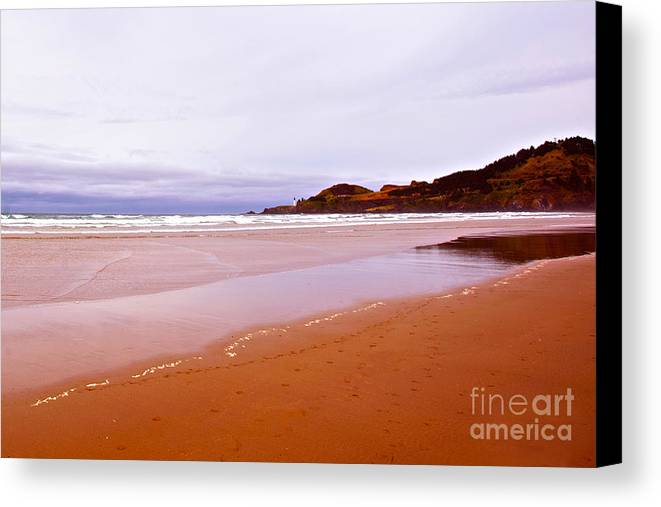 Agate Beach Oregon Canvas Print featuring the photograph Agate Beach Oregon With Yaquina Head Lighthouse by Artist and Photographer Laura Wrede