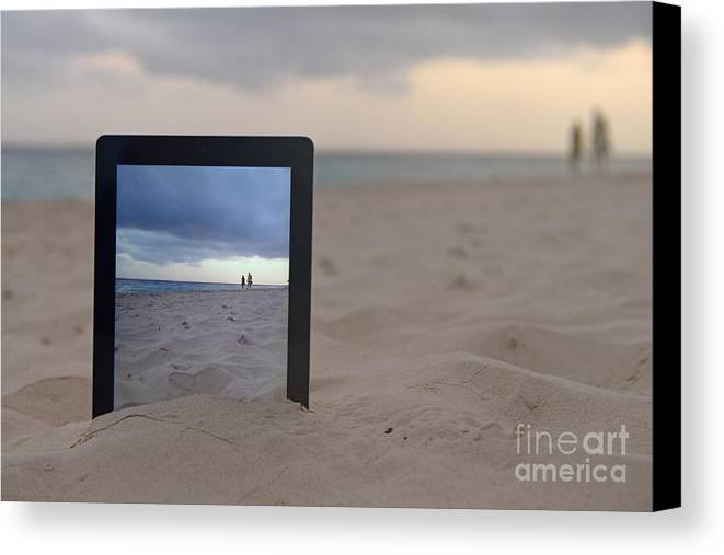 People Canvas Print featuring the photograph Digital Tablet In Sand On Beach by Sami Sarkis