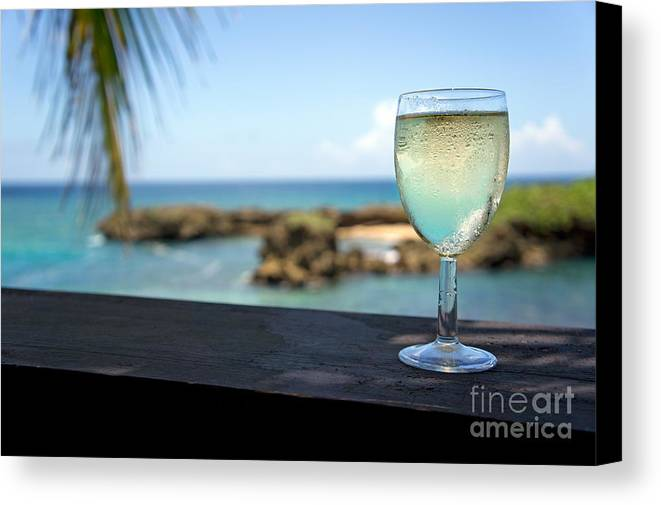 Freshness Canvas Print featuring the photograph Glass Of Fresh Wine By Tropical Beach by Sami Sarkis