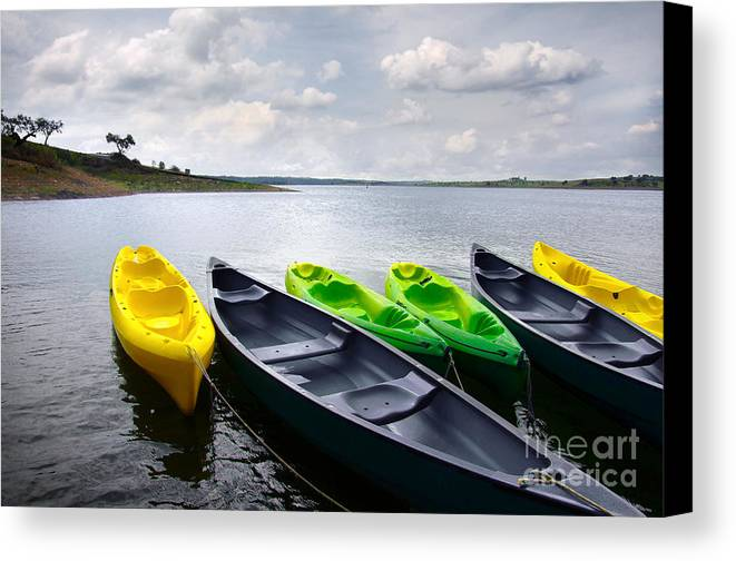 Activity Canvas Print featuring the photograph Green And Yellow Kayaks by Carlos Caetano