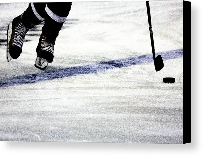 Hockey Canvas Print featuring the photograph He Skates by Karol Livote