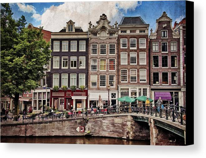 Amsterdam Canvas Print featuring the photograph In Another Time And Place by Joan Carroll