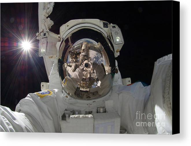 Space Canvas Print featuring the photograph Iss Expedition 32 Spacewalk by Nasa Jsc