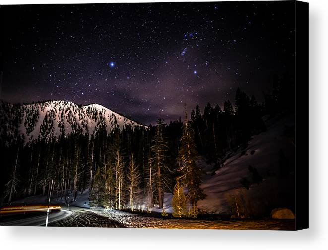 Astrophotography Canvas Print featuring the photograph Mt. Rose Highway And Ski Resort At Night by Scott McGuire