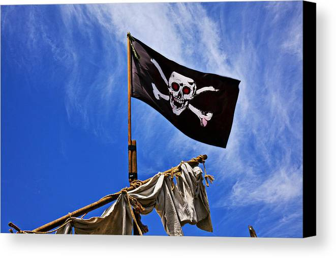 Pirate Flag Skull Banner Piracy Scull Robbers Terror Terrorist F Canvas Print featuring the photograph Pirate Flag On Ships Mast by Garry Gay