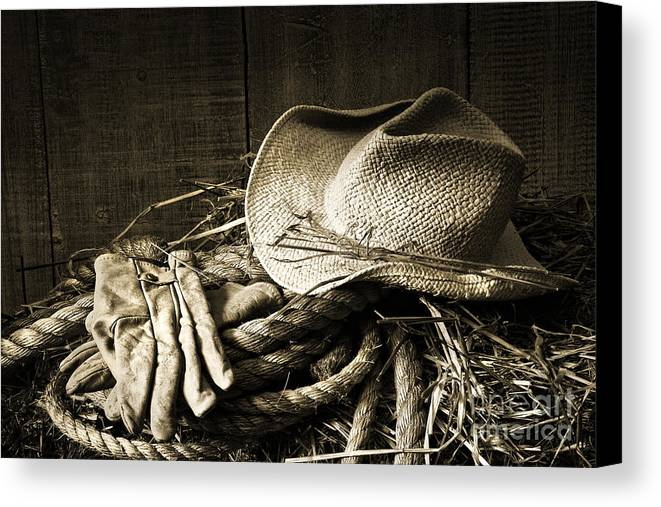 Bale Canvas Print featuring the photograph Straw Hat With Gloves On A Bale Of Hay by Sandra Cunningham