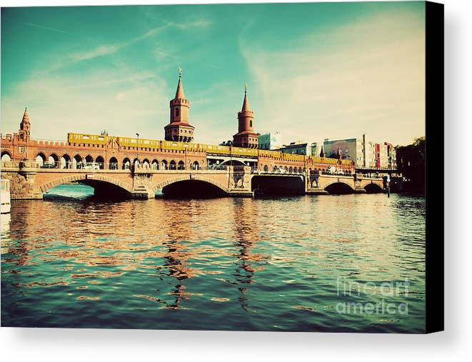 Oberbaum Canvas Print featuring the photograph The Oberbaum Bridge In Berlin Germany by Michal Bednarek