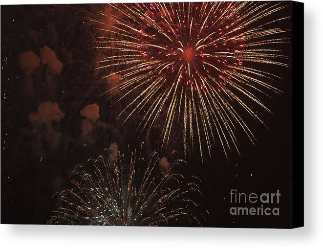 4th Of July Canvas Print featuring the photograph Fireworks by Juan Silva