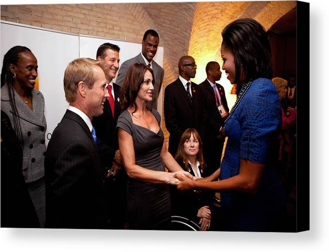 History Canvas Print featuring the photograph First Lady Michelle Obama Greets by Everett