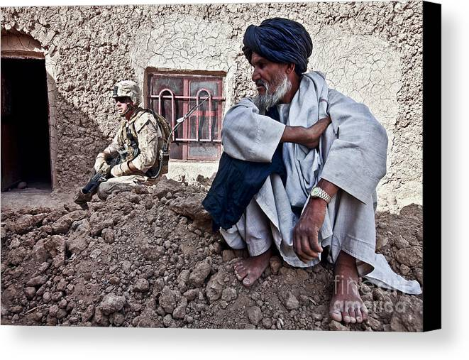 Middle East Canvas Print featuring the photograph A Soldier Collects Information by Stocktrek Images