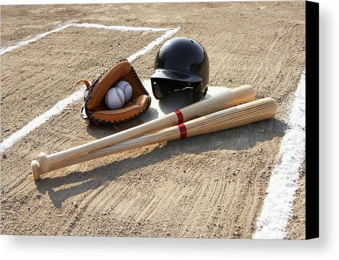 Horizontal Canvas Print featuring the photograph Baseball Glove, Balls, Bats And Baseball Helmet At Home Plate by Thomas Northcut