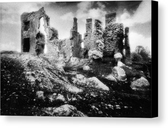 Ruins; Ruined; Remains; Abandoned; Chimneys; Stark; Glowing; Ethereal; Magical; Eerie; Mysterious; Mystery; Irish; Landscape; Architecture; Overgrown; Covered; Foliage Canvas Print featuring the photograph Castle Lyons by Simon Marsden