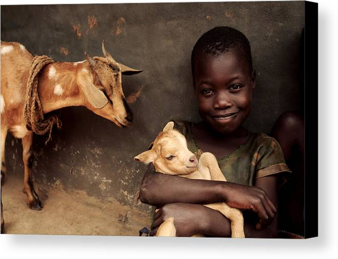 Livestock Canvas Print featuring the photograph Child Holding A Kid by Mauro Fermariello