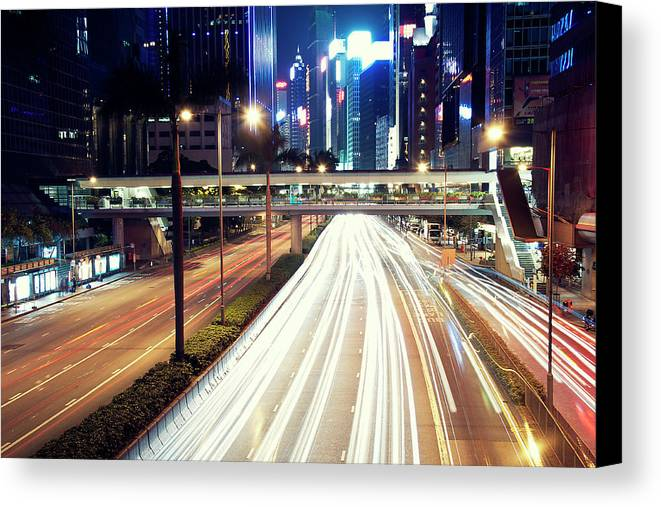 Horizontal Canvas Print featuring the photograph Light Trails At Traffic On Street At Night by Thank you for choosing my work.