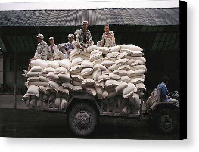Medium Group Of People Canvas Print featuring the photograph Men Sit On Bags Of Flour by Justin Guariglia