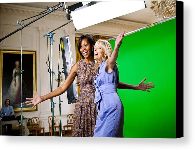 History Canvas Print featuring the photograph Michelle Obama And Jill Biden Joke by Everett