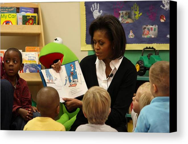History Canvas Print featuring the photograph Michelle Obama Reads The Cat In The Hat by Everett