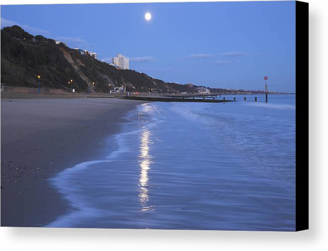 Horizontal Canvas Print featuring the photograph Moon Reflecting In The Sea, Bournemouth Beach, Dorset, England, Uk by Peter Lewis