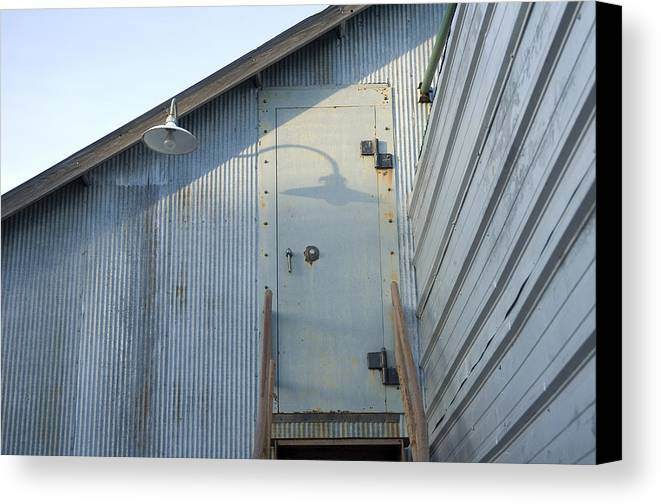 Cortland Canvas Print featuring the photograph The Entry To A Metal Shed On A Sawmill by Joel Sartore
