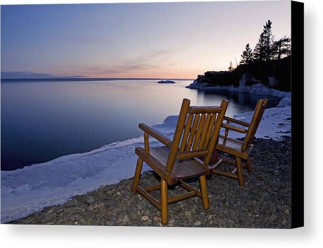 Sunset Canvas Print featuring the photograph Two Chairs At Waters Edge Looking Out by Susan Dykstra