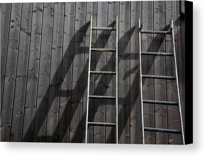 Horizontal Canvas Print featuring the photograph Two Ladders Leaning Against A Wooden Wall by Meera Lee Sethi
